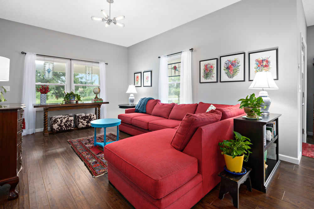 Couple Sitting on Couch in Living Room